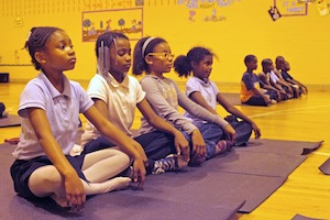 Kids learning mindfulness from the Holistic Life Foundation in Baltimore, Maryland.