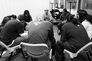 "Vinny Ferraro (center, wearing hat) of the <a href=""http://www.mbaproject.org/"">Mind Body Awareness Project</a> leads a workshop at a juvenile hall in the Bay Area."
