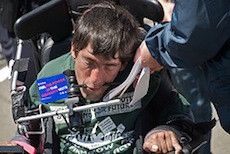 A disability activist signs a police citation at a protest of California health care budget cuts in June 2009.