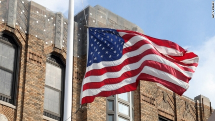 A flag flies at half-staff outside the funeral home where a private viewing for Whitney Houston was held Friday in Newark.