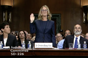 Dr. Christine Blasey Ford is sworn in to testify in the confirmation hearings of Supreme Court nominee Brett Kavanaugh.