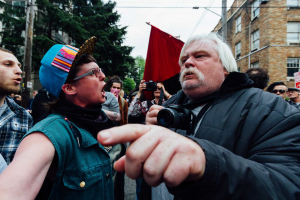 Protestors argue at an anti-capitalism protest in Seattle in 2015.