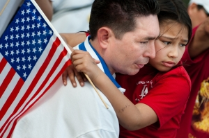A girl and her father rally for immigration reform in Washington, D.C.