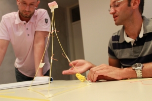 A team works on the Marshmallow Challenge.