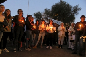 Students at Tamalpais High School in Mill Valley, CA, hold a vigil for the victims of the Parkland shooting.