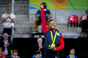 Simone Biles wins gold in artistic gymnastics at the Rio 2016 Olympics.
