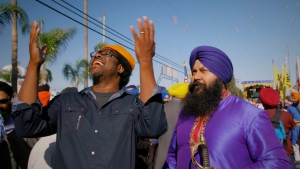 W. Kamau Bell (left) in the Sikh community episode of <em>United Shades of America</em>