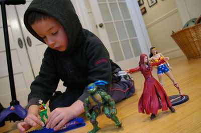 The author's youngest son, Julian, has started to reject playing with female action figures.