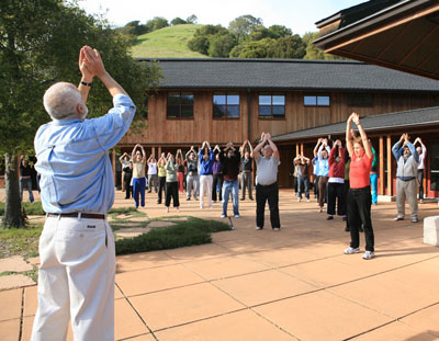 Charles Halpern (left, foreground) leads a Qigong exercise at a retreat for 75 lawyers at the Spirit Rock Meditation Center in California.