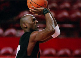 Michael Jordan shooting a free throw with his eyes closed.