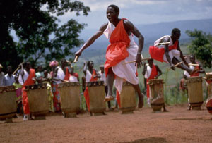 Gitaga drummers and dancers perform in Burundi. Throughout history, artistic ceremonies such as this one have fostered social bonding.