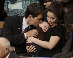 Levi Johnston, 18, kisses Trig, brother of his girlfriend Bristol Palin, 17, as he holds him during the Republican National Convention in September. Weeks earlier, Ms. Palin had announced she as pregnant, and that Mr. Johnston was the father.