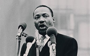 """""""I refuse to accept the view that mankind is so tragically bound to the starless midnight of racism and war that the bright daybreak of peace and brotherhood can never become a reality.""""—Martin Luther King Jr."""