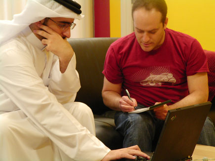 Burak receives feedback on PeaceMaker from a student who tested the game in Qatar