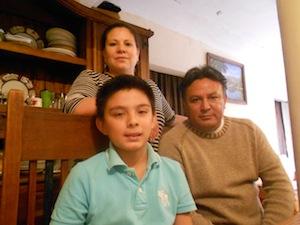 Rodrigo Guzman and his parents in Mexico