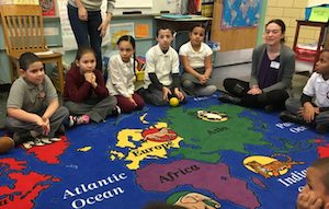 All students at P.S. 154 begin their day with a morning meeting.