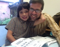 The author and his son doing homework in the offices of the Greater Good Science Center at UC Berkeley.